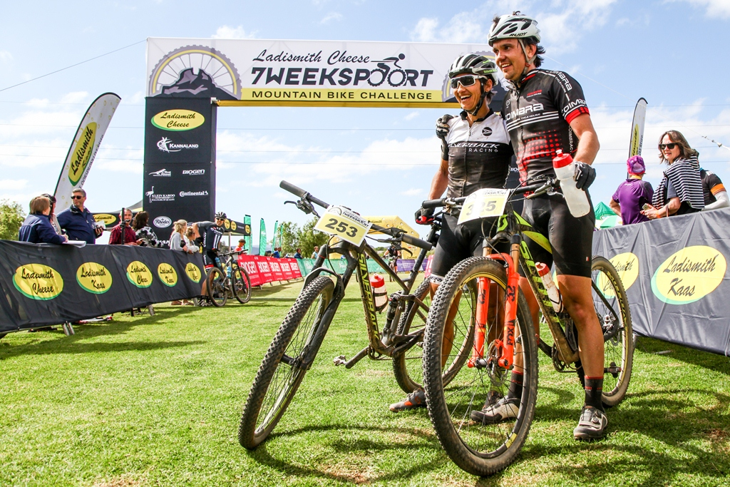 Ladies' champion Yolande de Villiers and Jan-Paul Gerber embrace after a sprint for second overall behind David Garrett at the 2017 Ladismith Cheese 7Weekspoort MTB Challenge. Photo by Oakpics.com.